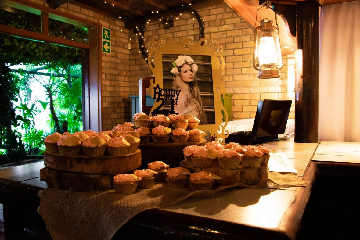 rustic and elegant birthday celebration cake display and dinning area at thatchwoods photoshoot